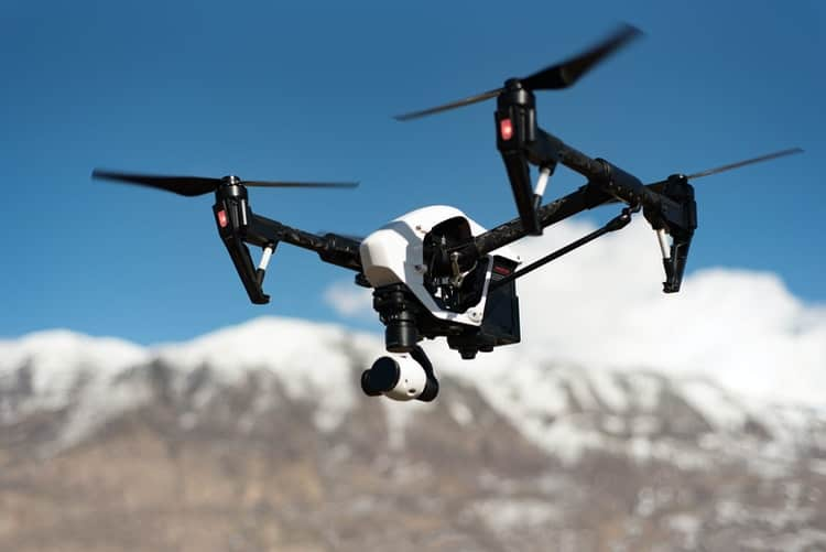 A person flying through the air while riding skis