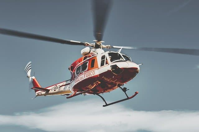 A helicopter flying over a body of water