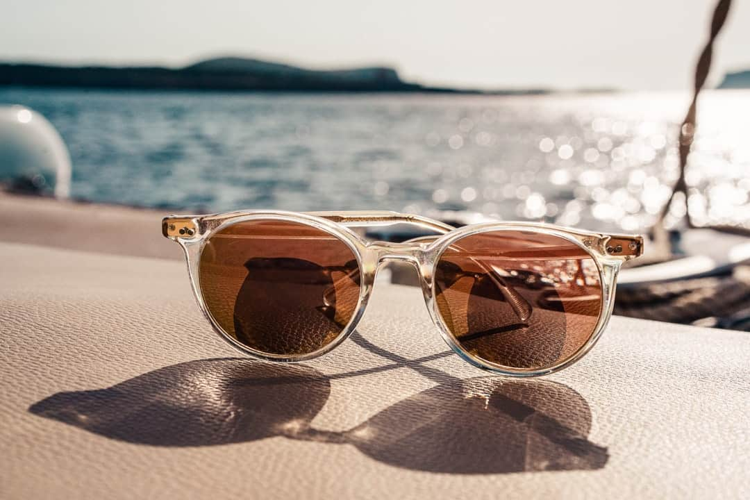 A close up of sunglasses on a table